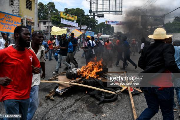 Tyres are burned during a protest against the ruling government on Haitian Flag Day in PortauPrince May 18 2019