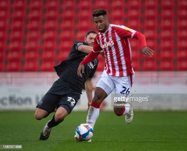 Tyrese Campbell of Stoke City and Henrik Dalsgaard of Brentford in action during the Sky Bet Championship match between Stoke City and Brentford at...