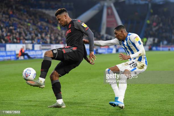 Tyrese Campbell of Stoke City battles for possession with Jaden Brown of Huddersfield Town during the Sky Bet Championship match between Huddersfield...