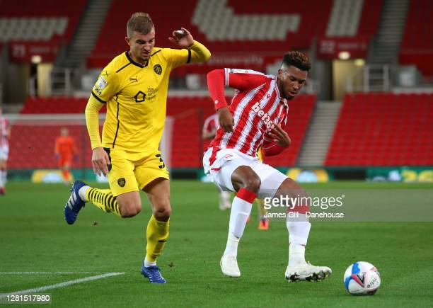 Tyrese Campbell of Stoke City battles for the ball with Michal Helik of Barnsley during the Sky Bet Championship match between Stoke City and...