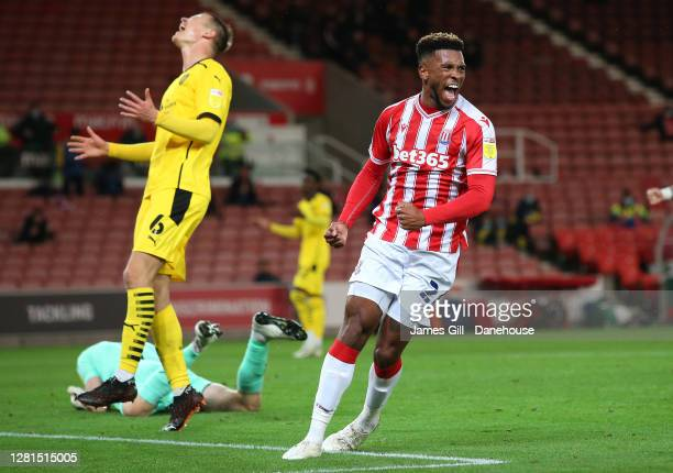 Tyrese Campbell of Stoke City celebrates after scoring their first goal as Mads Juel Andersen of Barnsley reacts during the Sky Bet Championship...