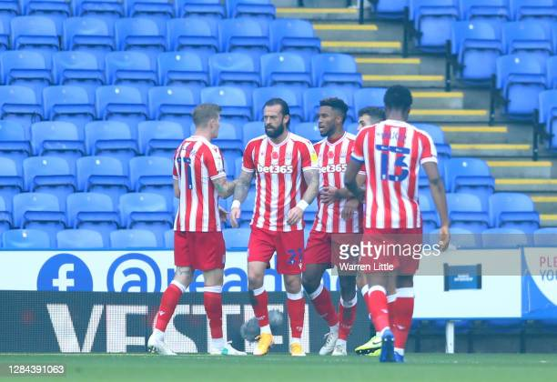 Tyrese Campbell of Stoke City celebrates with teammates after scoring his team's first goal during the Sky Bet Championship match between Reading and...