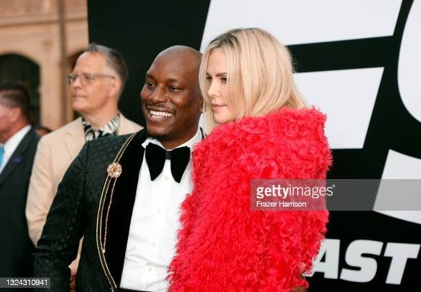 """Tyrese Gibson and Charlize Theron attend the Universal Pictures """"F9"""" World Premiere at TCL Chinese Theatre on June 18, 2021 in Hollywood, California."""
