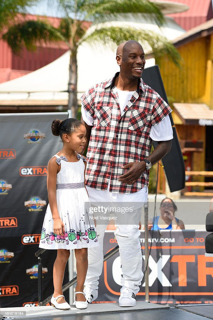 Tyrese Gibson (R) and his daughter Shayla Somer Gibson visit 'Extra' at Universal Studios Hollywood on August 19, 2015 in Universal City, California.