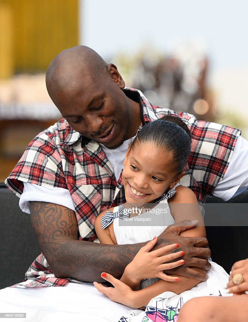 Tyrese Gibson (L) and his daughter Shayla Somer Gibson visit 'Extra' at Universal Studios Hollywood on August 19, 2015 in Universal City, California.