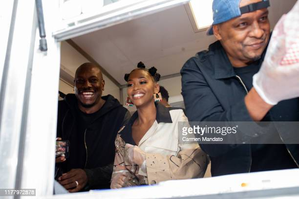 Tyrese Gibson Nafessa Williams and Deon Taylor are seen serving from a food truck during the Black Blue cast members' visit to Morehouse College on...