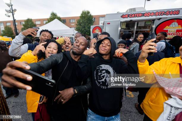 Tyrese Gibson takes a selfie with fans during the Black Blue cast members' visit to Morehouse College on October 24 2019 in Atlanta Georgia