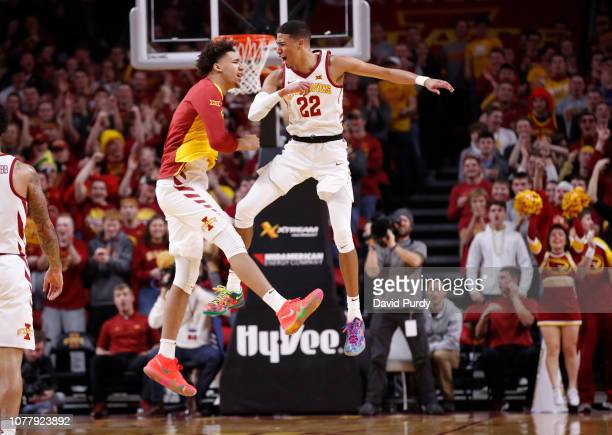 Tyrese Haliburton of the Iowa State Cyclones celebrates with George Conditt IV of the Iowa State Cyclones after sinking a 3 point shot in the first...