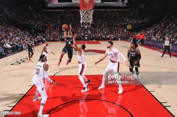 Tyrese Haliburton of the Sacramento Kings shoots the ball during the game against the Portland Trail Blazers on October 20, 2021 at the Moda Center...