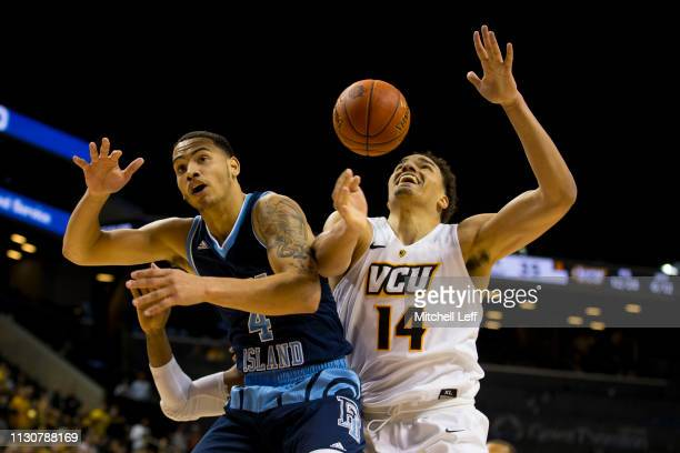 Tyrese Martin of the Rhode Island Rams and Marcus SantosSilva of the Virginia Commonwealth Rams fight for the ball during the quarterfinals of the...