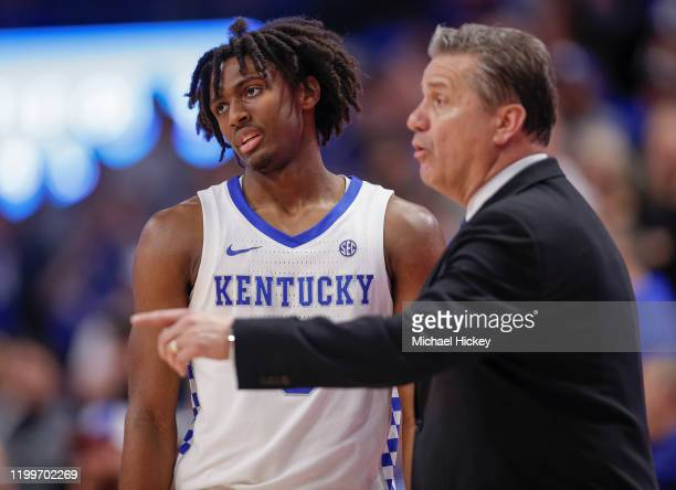 Tyrese Maxey listens to head coach John Calipari of the Kentucky Wildcats during the game against the Mississippi State Bulldogs at Rupp Arena on...
