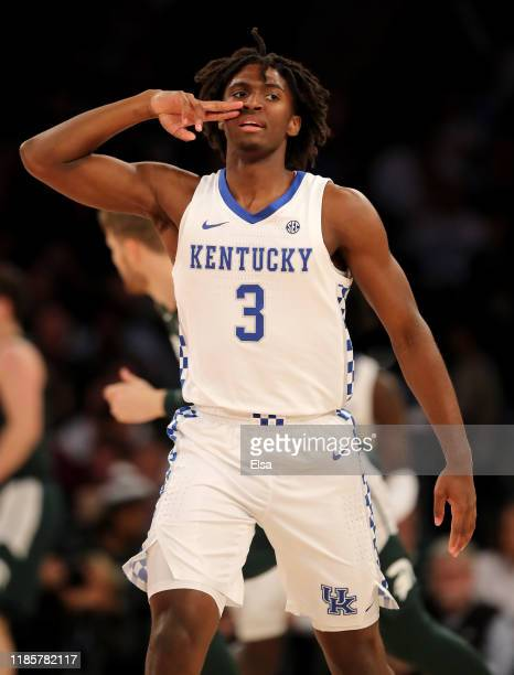 Tyrese Maxey of the Kentucky Wildcats celebrates his three point shot in the first half against the Michigan State Spartans during the State Farm...