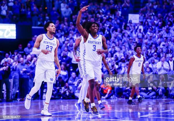 Tyrese Maxey of the Kentucky Wildcats celebrates with his teammates after taking the lead from the Florida Gatos during the second half of the game...