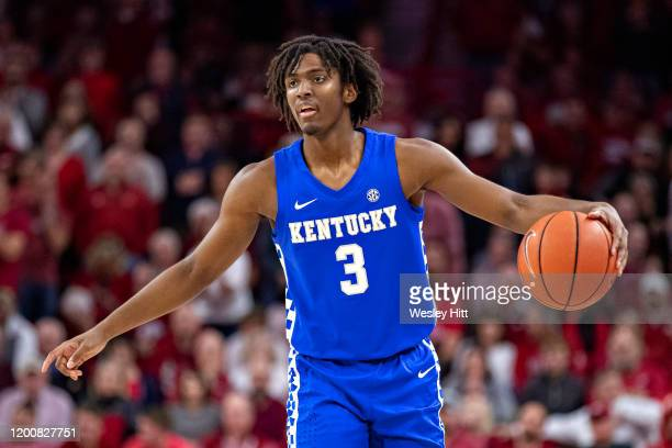 Tyrese Maxey of the Kentucky Wildcats directs the offense during a game against the Arkansas Razorbacks at Bud Walton Arena on January 18, 2020 in...