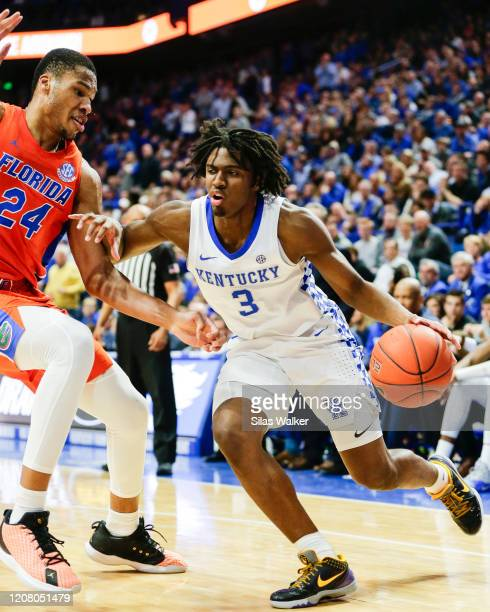 Tyrese Maxey of the Kentucky Wildcats dribbles the ball while guarded by Kerry Blackshear Jr. #24 of the Florida Gators during the second half of the...