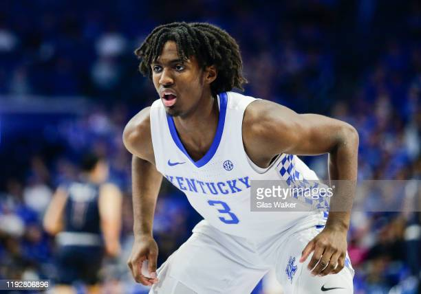 Tyrese Maxey of the Kentucky Wildcats guards a member of the Fairleigh Dickinson Knights during the second half of the game at Rupp Arena on December...