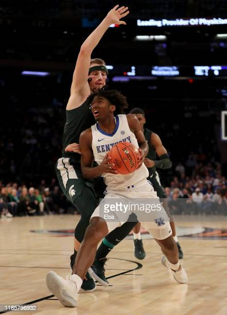 Tyrese Maxey of the Kentucky Wildcats heads for the net as Thomas Kithier of the Michigan State Spartans defends during the State Farm Champions...