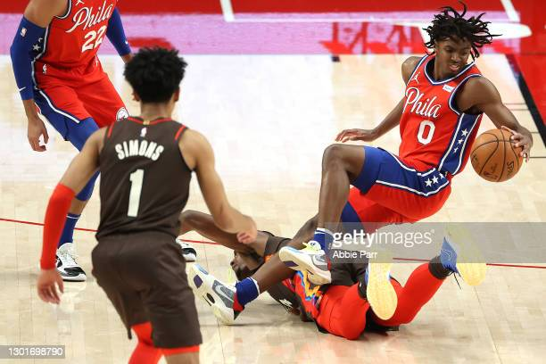 Tyrese Maxey of the Philadelphia 76ers collides with Harry Giles III of the Portland Trail Blazers in the second quarter at Moda Center on February...