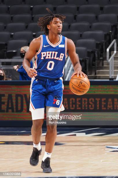 Tyrese Maxey of the Philadelphia 76ers dribbles during a preseason game against the Indiana Pacers on December 18, 2020 at Bankers Life Fieldhouse in...