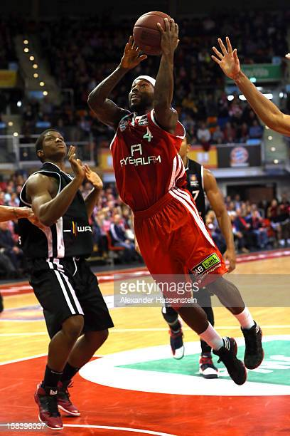 Tyrese Rice of Muenchen shoots against Cameron Wells of Tuebingen during the Beko Basketball match between FC Bayern Muenchen and Walter Tigers...