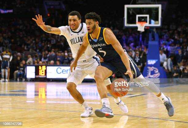 Tyrese Williams of the Quinnipiac Bobcats in action against Jahvon Quinerly of the Villanova Wildcats during a game at Wells Fargo Center on November...