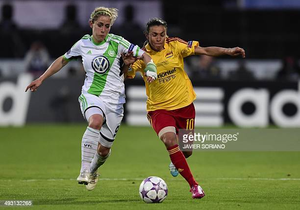 Tyreso's Brazilian forward Marta runs for the ball with Wolfsburg's midfielder Anna Blaesse during the UEFA Women's Champions League final football...