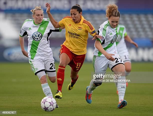 Tyreso's US forward Christen Press vies with Wolfsburg's defender Stephanie Bunte and Wolfsburg's defender Josephine Henning during the UEFA Women's...