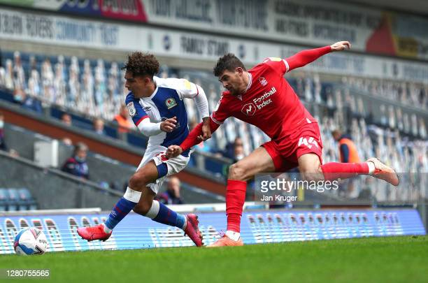 Tyrhys Dolan of Blackburn Rovers battles with Nicholas Ioannou of Nottingham Forest during the Sky Bet Championship match between Blackburn Rovers...