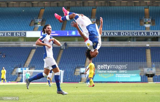 Tyrhys Dolan of Blackburn Rovers celebrate scoring his sides second goal with his fellow team mates during the Sky Bet Championship match between...