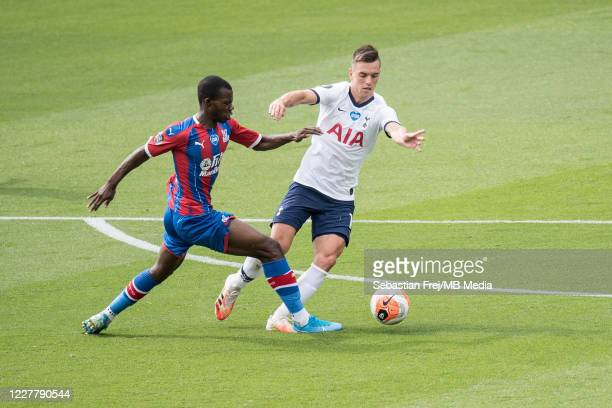 Tyrick Mitcchell of Crystal Palace and Giovani Lo Celso of Tottenham Hotspur in action during the Premier League match between Crystal Palace and...