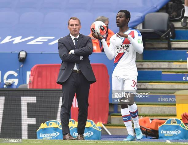 Tyrick Mitchell of Crystal Palace with a throw in as Leicester City manager Brendan Rogers looks on during the Premier League match between Leicester...