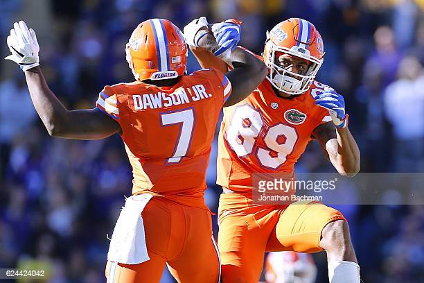 Tyrie Cleveland of the Florida Gators and Duke Dawson celebrate after Florida recovered a fumble during the second half of a game against the LSU...