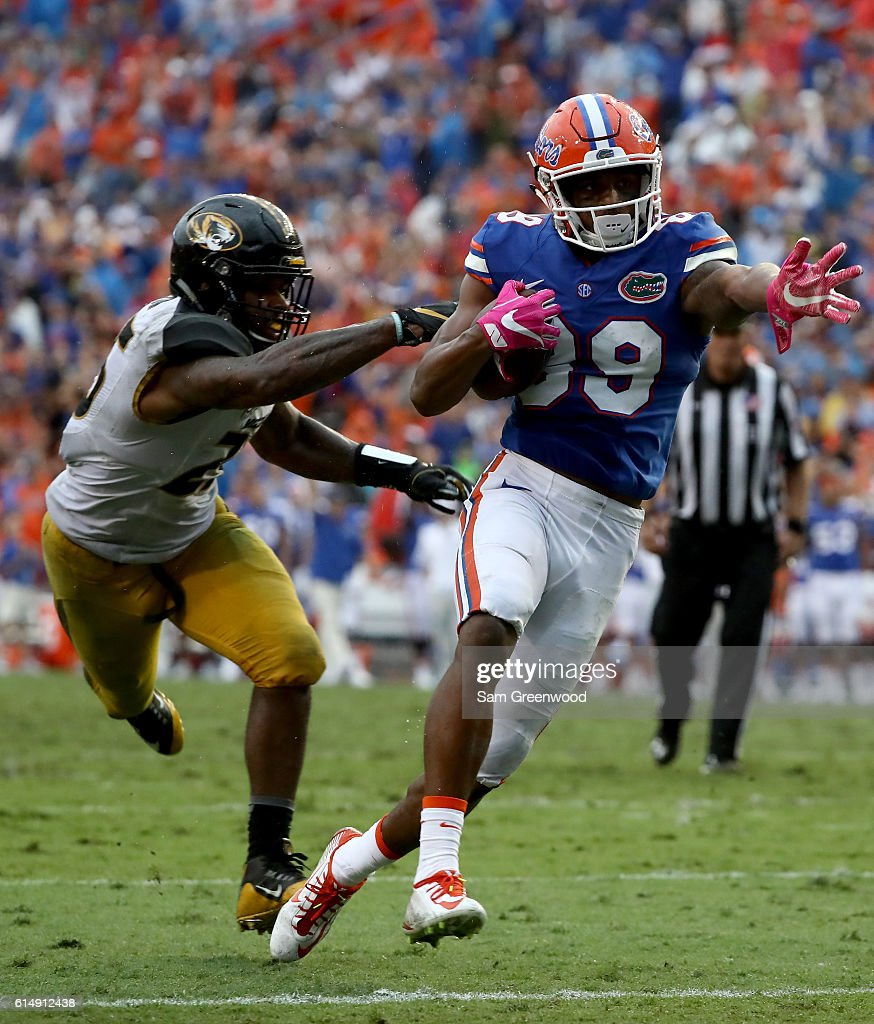 Tyrie Cleveland #89 of the Florida Gators rushes past Donavin Newsom #25 of the Missouri Tigers at Ben Hill Griffin Stadium on October 15, 2016 in Gainesville, Florida.
