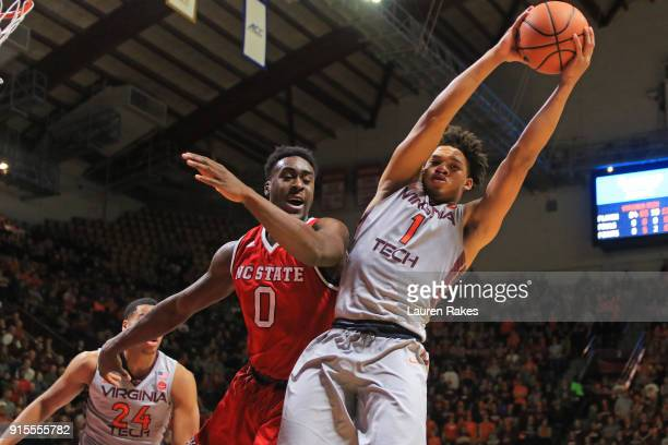 Tyrie Jackson of the Virginia Tech Hokies gets the rebound against Abdul-Malik Abu of the NC State Wolfpack in the first halfat Cassell Coliseum on...
