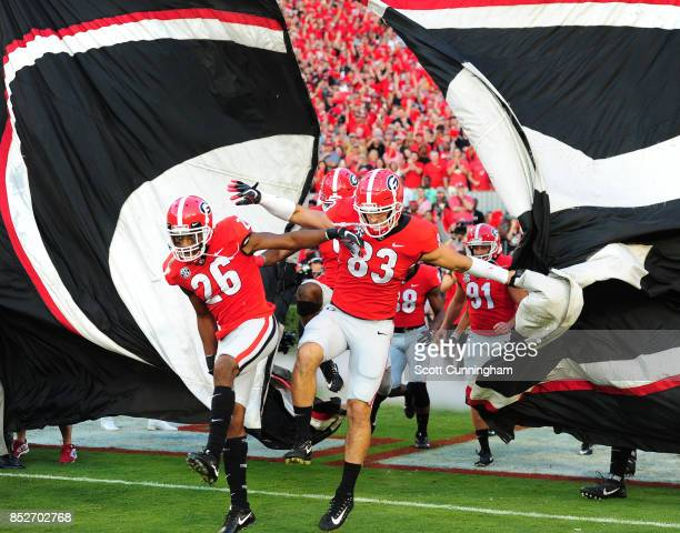 Tyrique McGee and Jeb Blazevich of the Georgia Bulldogs take the field before the game against the Mississippi State Bulldogs at Sanford Stadium on...