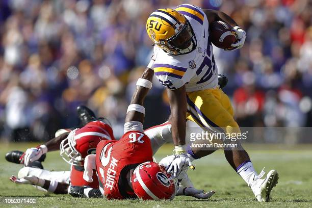 Tyrique McGhee of the Georgia Bulldogs tackles Clyde EdwardsHelaire of the LSU Tigers during the first half at Tiger Stadium on October 13 2018 in...