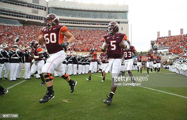 Tyrod Taylor and Beau Warren of the Virginia Tech Hokies take the field before the game against the Nebraska Cornhuskers at Lane Stadium on September...
