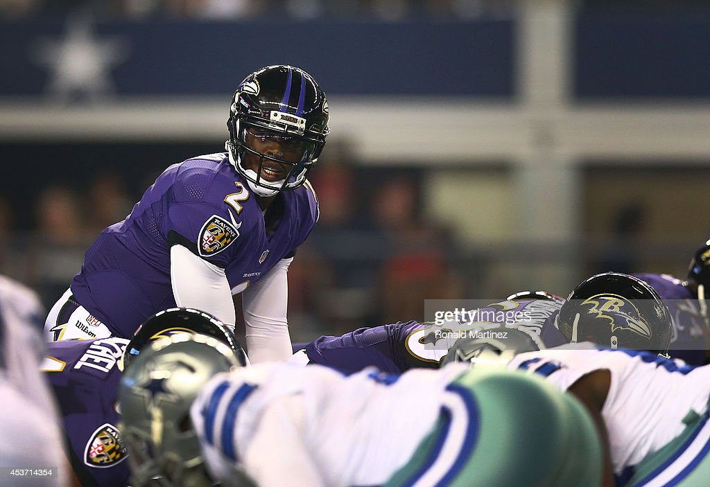 Tyrod Taylor #2 of the Baltimore Ravens stands under center against the Dallas Cowboys in the second half of the preseason game at AT&T Stadium on August 16, 2014 in Arlington, Texas.