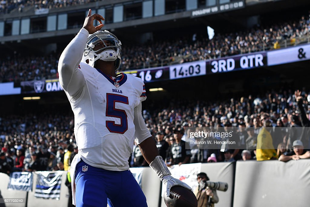 Tyrod Taylor #5 of the Buffalo Bills celebrates after 12-yard touchdown against the Oakland Raiders during their NFL game at Oakland Alameda Coliseum on December 4, 2016 in Oakland, California.