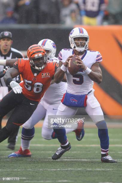 Tyrod Taylor of the Buffalo Bills drops back to pass against Carl Lawson of the Cincinnati Bengals during their game at Paul Brown Stadium on October...