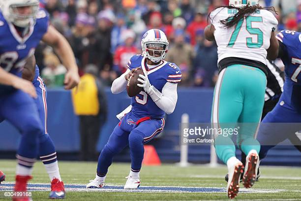 Tyrod Taylor of the Buffalo Bills drops back to pass against the Miami Dolphins during the first half at New Era Stadium on December 24 2016 in...