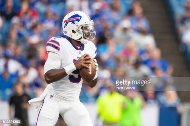 Tyrod Taylor of the Buffalo Bills drops back to pass during the first quarter of a preseason game against the Minnesota Vikings on August 10 2017 at...