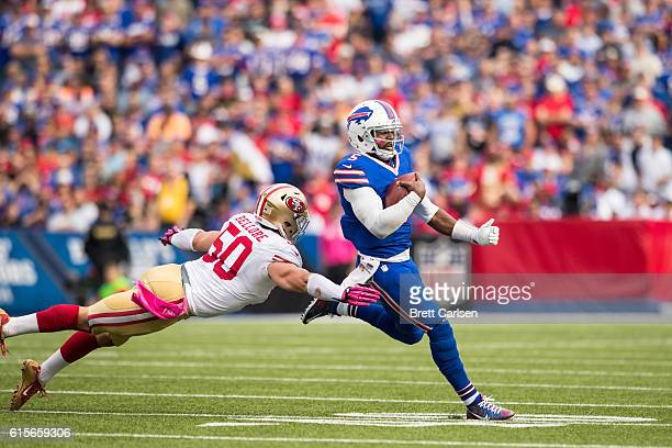 Tyrod Taylor of the Buffalo Bills evades a tackle by Nick Bellore of the San Francisco 49ers during the second half on October 16 2016 at New Era...