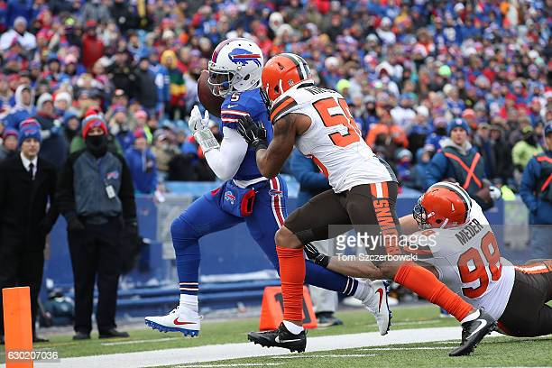 Tyrod Taylor of the Buffalo Bills gets run out of bounds by Christian Kirksey of the Cleveland Browns during the first half at New Era Field on...