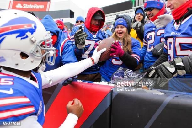 Tyrod Taylor of the Buffalo Bills gives the ball to a young fan after scoring a touchdown during the second quarter against Miami Dolphins on...