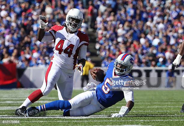 Tyrod Taylor of the Buffalo Bills goes down after carrying the ball during NFL game action as Markus Golden of the Arizona Cardinals closes in at New...