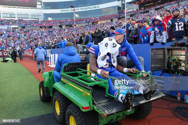 Tyrod Taylor of the Buffalo Bills is carted off the field during the fourth quarter against the New England Patriots on December 3 2017 at New Era...
