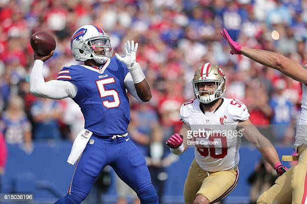 Tyrod Taylor of the Buffalo Bills is pursued by Nick Bellore of the San Francisco 49ers during the first half at New Era Field on October 16, 2016 in...