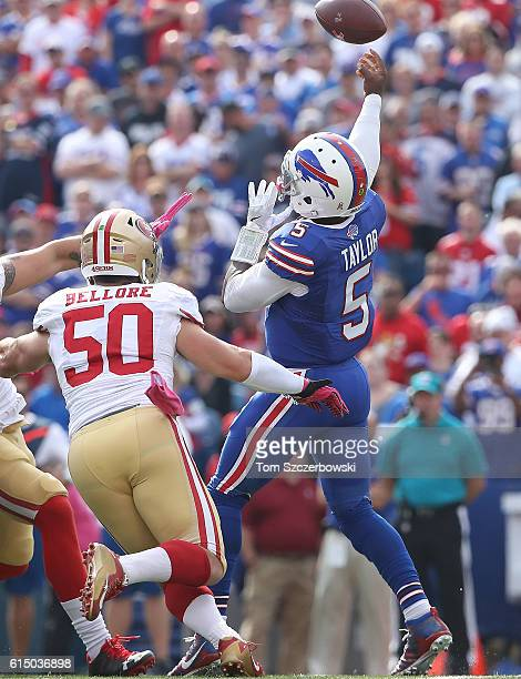 Tyrod Taylor of the Buffalo Bills is pursued by Nick Bellore of the San Francisco 49ers during the first half at New Era Field on October 16 2016 in...