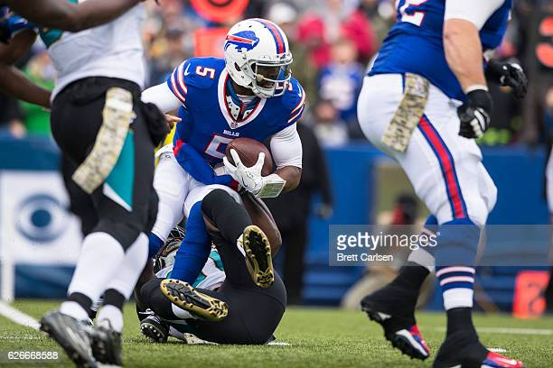 Tyrod Taylor of the Buffalo Bills is sacked by Yannick Ngakoue of the Jacksonville Jaguars during the second quarter on November 27 2016 at New Era...